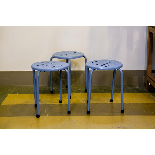 Set of three Mid Century Modern blue metal stools from France, circa 1960. Newly powder coated with blue paint and new...