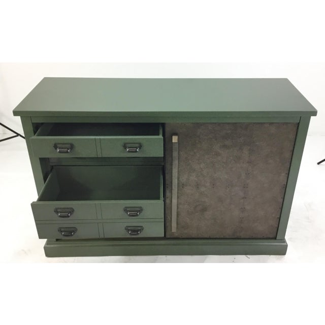 Stylish, organic, industrial green sliding door console, four drawers and sliding taupe metal door with riot detail , one...