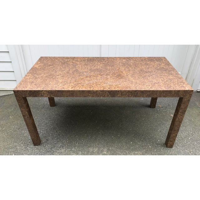 Clean lines define the style of this Dark Burl Wood Laminate Parsons Table. Use it as a dining table or a desk. A matte...
