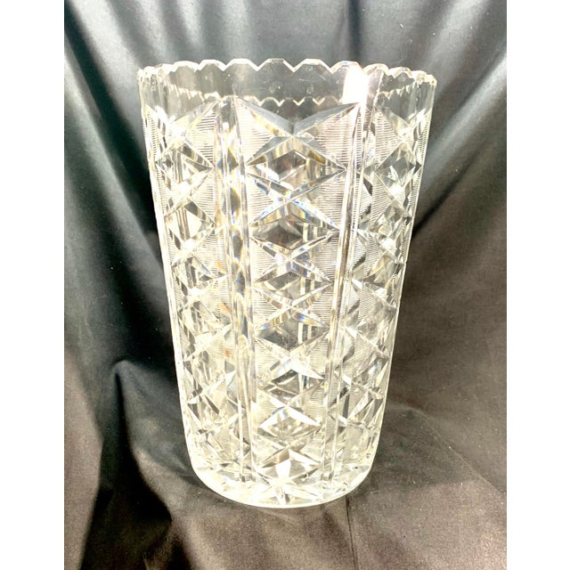 Offered is a large and heavy cut crystal vase. My mad this for decades. I thought it was Waterford, but I do not find a...