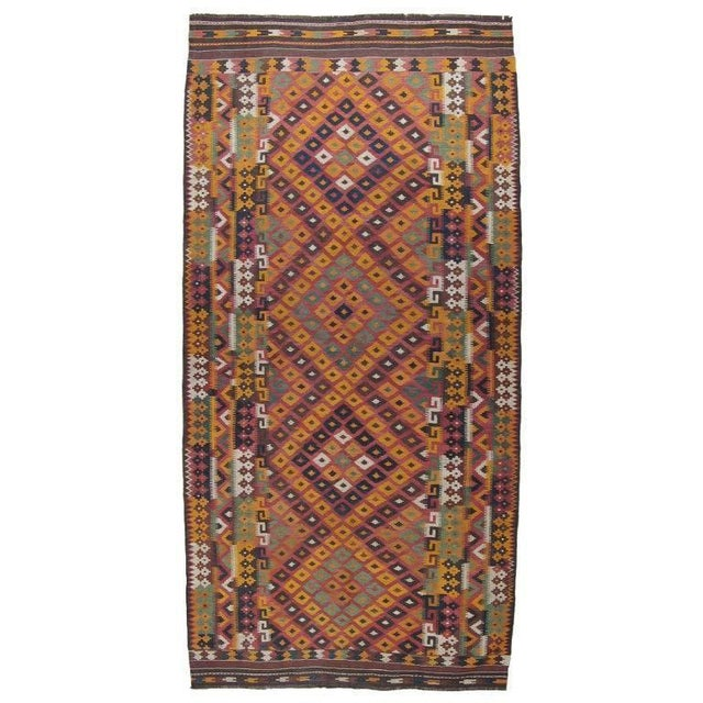 Vintage Uzbek kilim with typical vibrant color palette and lots of interesting design details. Very sturdy type.