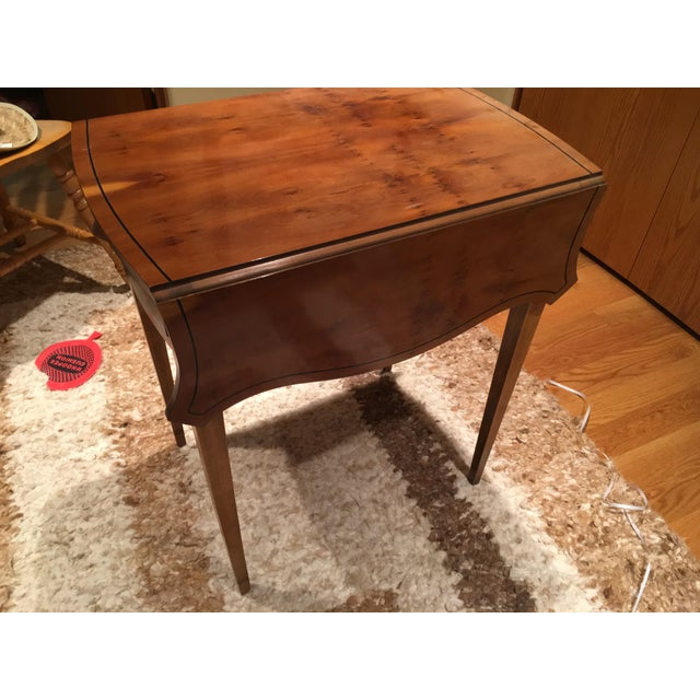 Lovely Baker drop leaf side table bought new about 1980. I think it is cherry. There is one small bad spot in finish which...