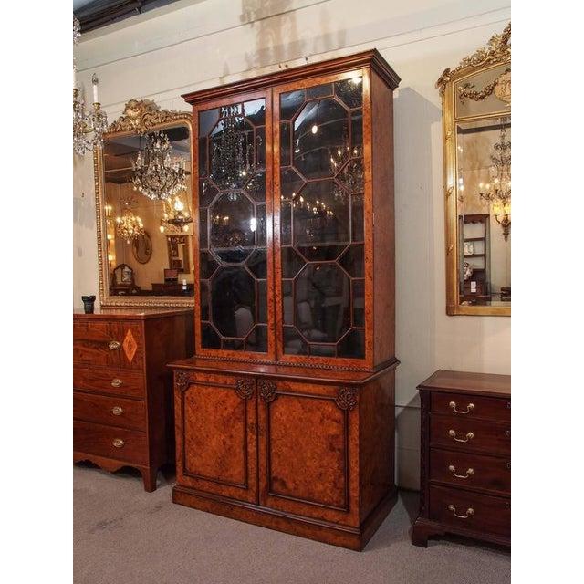 Antique English Georgian burl walnut bookcase.