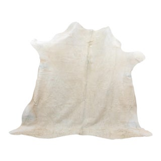 Brazilian Ivory Cow Hide Rug - 7′ × 7′4″ For Sale