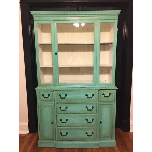 Vintage Hand painted China Cabinet using a custom paint and protective topcoat. The design is distressed, layers of...