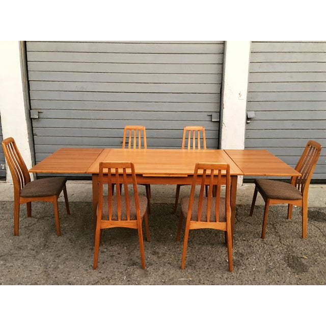 This wonderful dining set with six chairs, made of teak wood, is in very good condition. All pieces are strong and very...