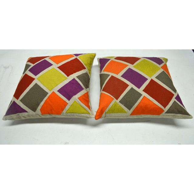 Ideal for adding a pop of color to a space, this cheerful pair of linen pillows features a geometric inlay of colorful,...