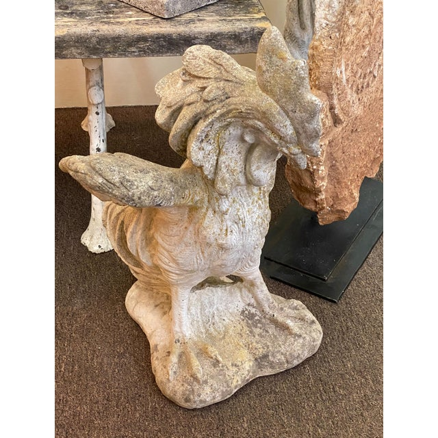An antique cement rooster from France to add a bit of whimsy to your garden decor.