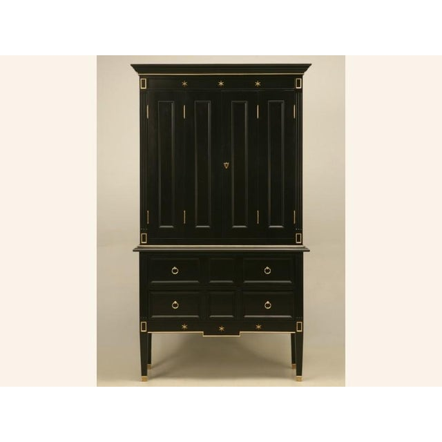 Absolutely stunning petite French forties style cupboard with a top section having double bi-fold doors over a lower...