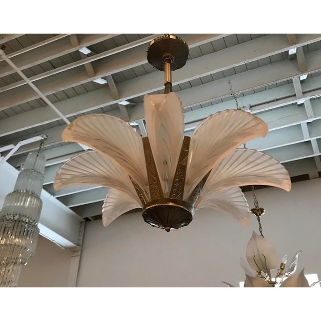 """Stunning French Art Deco """"feather"""" chandelier. Having eight clear frosted glass panels with ribbed geometric motif. Held..."""