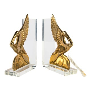 New Old Stock Dolbi Cashier Brass and Lucite Pelican Bookends For Sale