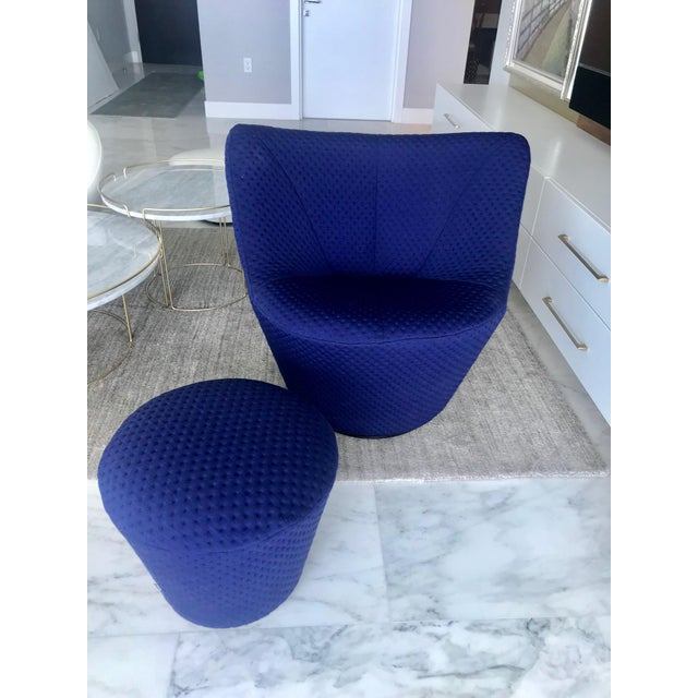 Outstanding swivel lounge chair and matching ottoman designed by Pierre Paulin. Modernist design with elegant curves...