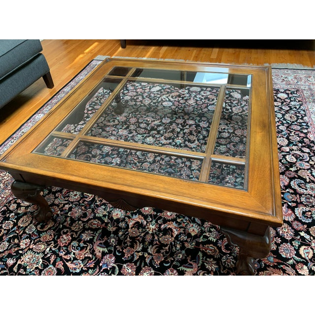Square glass and wood coffee table. Made in the 1970s.