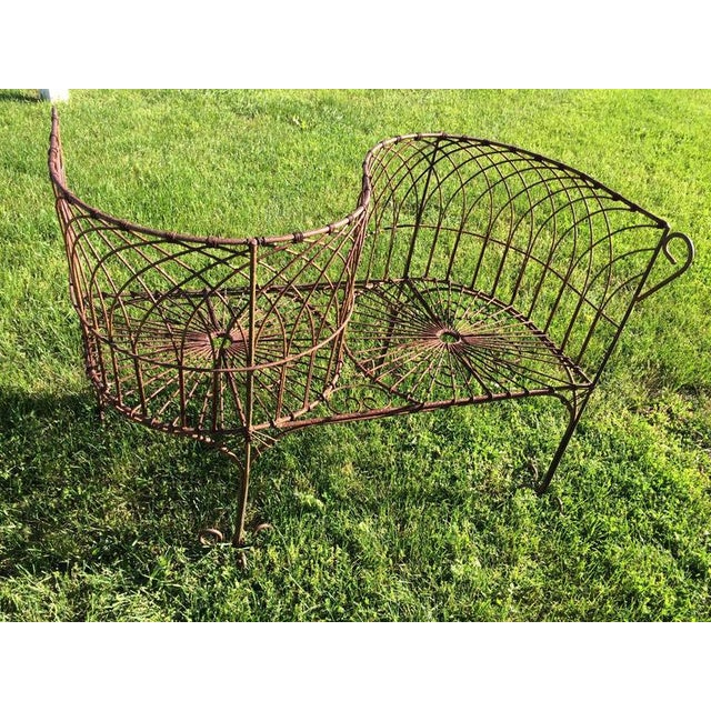 Classic sculptural garden tete a tete in iron. This piece would be a great focal point for a garden. This romantic,...