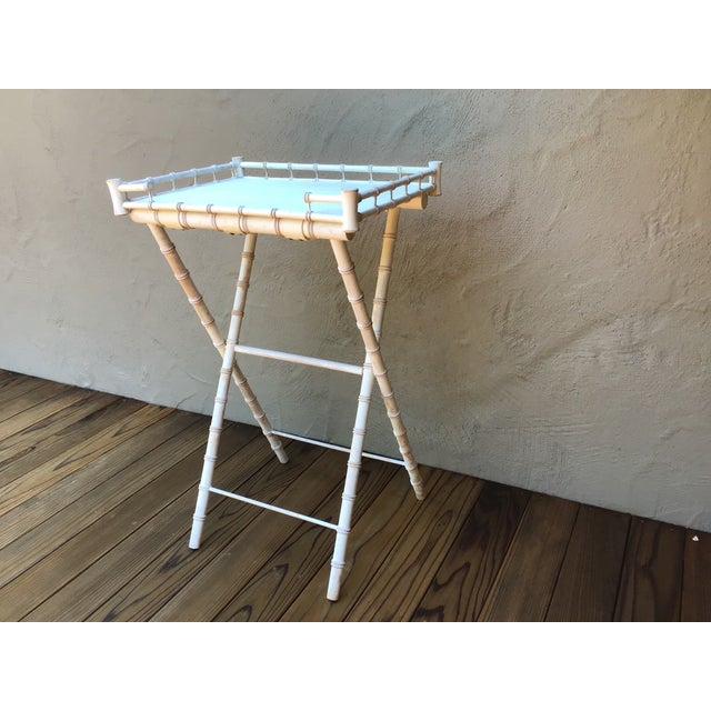 Unique Bar/Buttler's stand, faux bamboo with original paint in 'as is' condition. Very functional, folding and easy to...