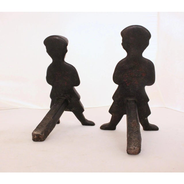 "A pair of ""Scottish Smoker"" andirons, early-mid 19th century, cast iron. Rare!"