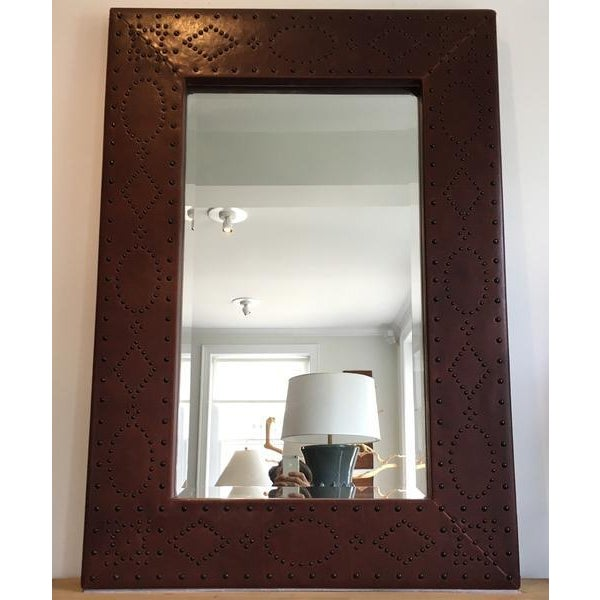 Brown leather-wrapped hardwoods with antique brass trim. Beveled edge mirror. Condition: Like new