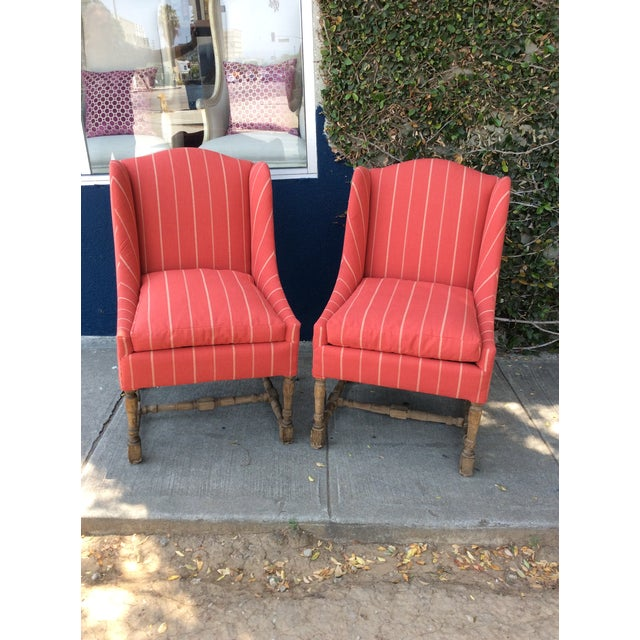 Pair of newly reupholstered armless side chairs. Great brick red fabric with small cream/yellow stripes. Decorative wood...