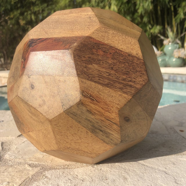 Solid wood with layers of different colored wood with unique wood grains. I love that this sculptural piece looks...