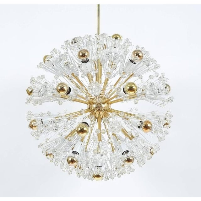 Gorgeous pair of Emil Stejnar chandeliers for Rupert Nikoll, circa 1955, featuring a 24 inches sphere of dandelions and 36...