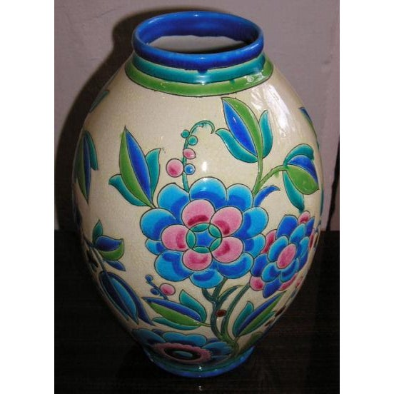 A Boch Freres vase, painted in pink and blue, and glazed to give it an enameled cloisonne appearance. Made in Belgium and...