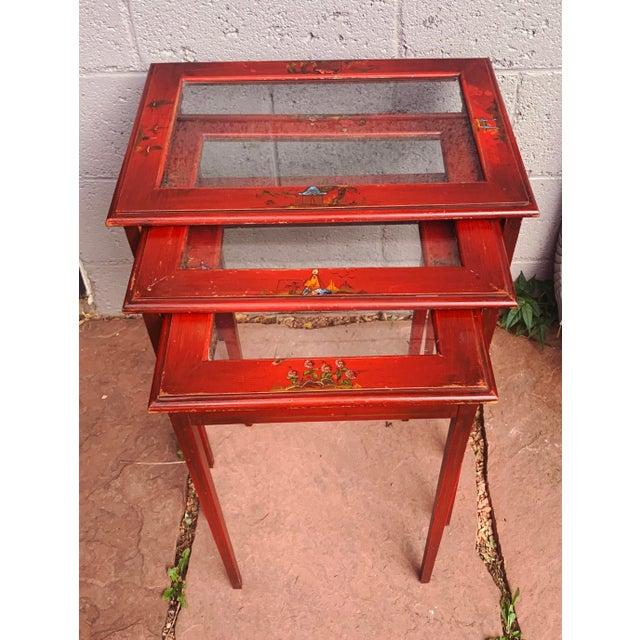 Charming Red Lacquer Japanese nesting tables with glass. These lovely side tables made of red lacquer feature hand painted...