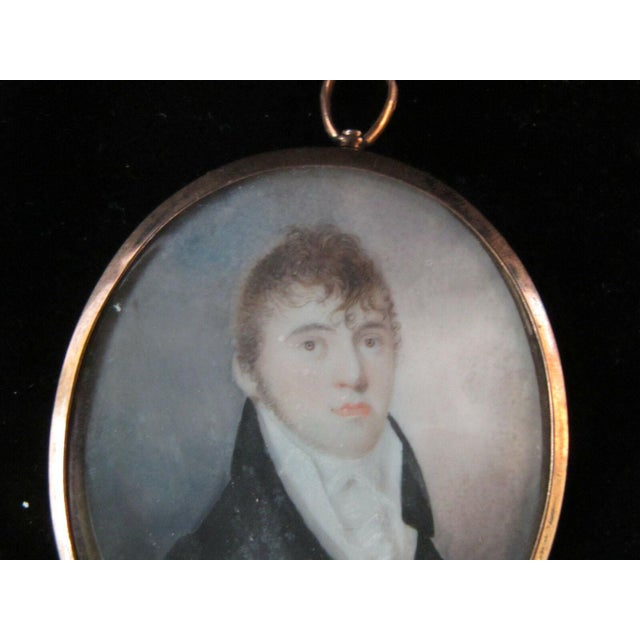 Wonderful 18th century miniature painting of a handsome young man. Very good condition, portrait is loose in frame. Oval...