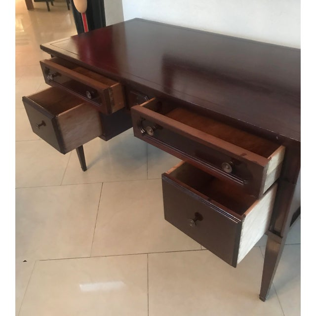 This writing desk by Bassett Furniture is in great condition. Modern sleek look with 5 drawers very sturdy great look.