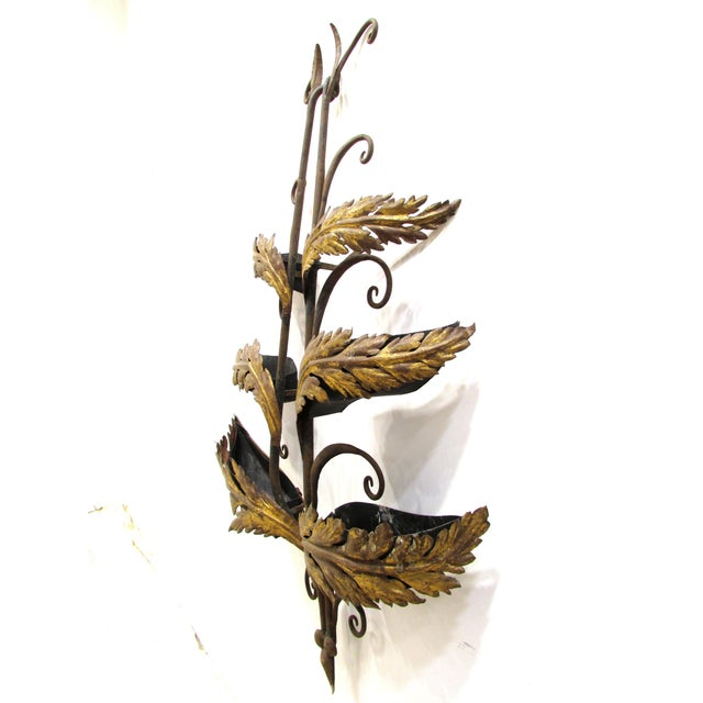 Handmade hand-wrought iron garden wall hanging sculpture with gilt leaves has inset metal containers being the gilt leaves...