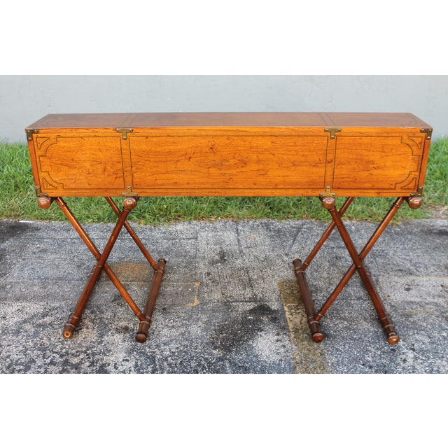 A vintage roll top writing desk beautifully crafter. Campaign style, heavy brass hardware. 5 drawers and 8 compartments.