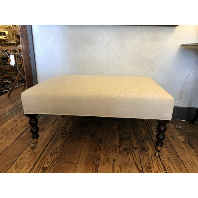 Classic rectangular George Smith style ottoman newly upholstered in neutral plush beige chenille and having turned...