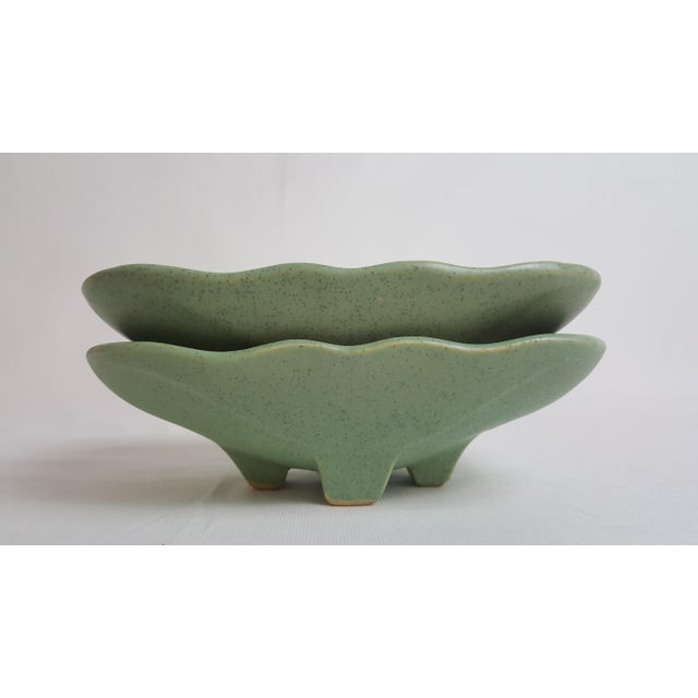 Offered is a pair of mid century era celadon green/brown fleck semi gloss glaze planters by McCoy. This pair has beautiful...