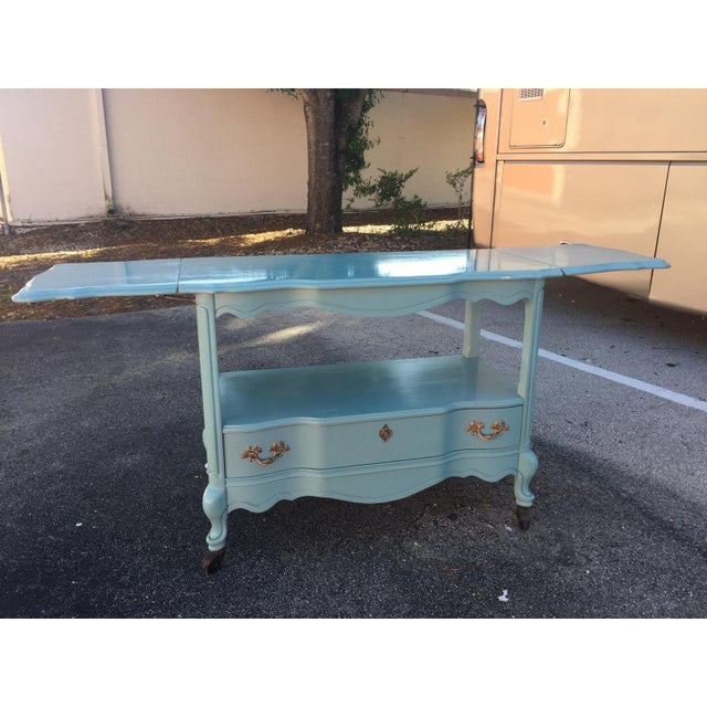"Farmhouse-Style Rolling Serving Cart In Tiffany Blue. One Drawer And Two Drop-Down Leafs Fully Extended, 66""."