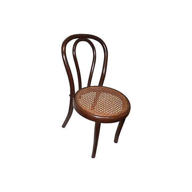 Very sweet bentwood child's chair with cane seat. Perfect for that little one! Vintage 1910-1950, excellent condition.