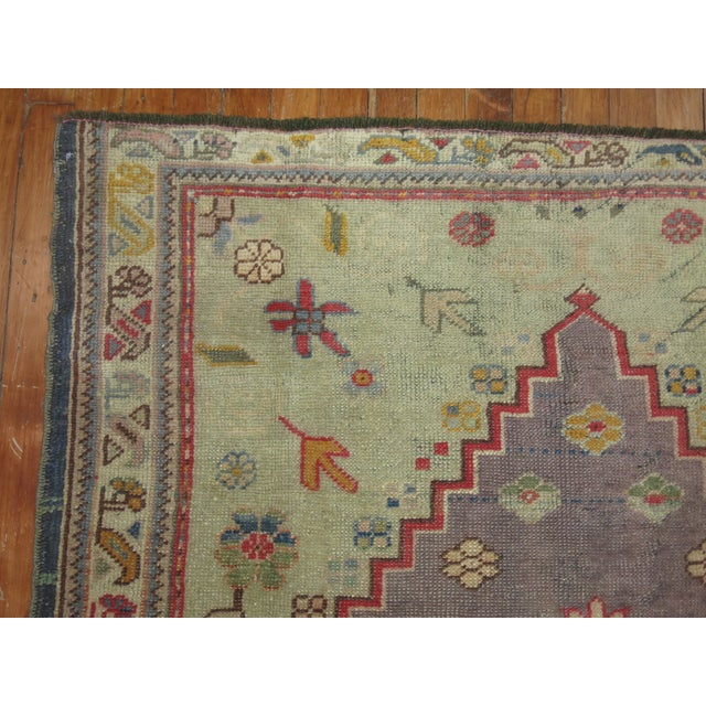Hand-knotted One of a kind Vintage Turkish Oushak rug with medallion and border design on a rare purple field. circa 1940.