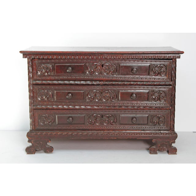 A Spanish 18th century beautifully patinated 3 drawer walnut chest. Front frame and drawers are heavily carved, while the...