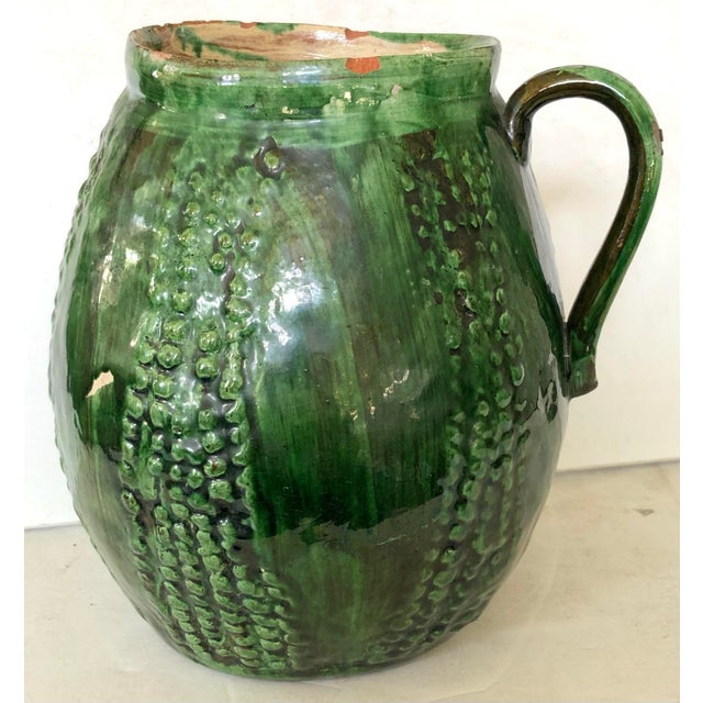 Beautiful French majolica jug with various shades of green glaze creating lovely depth to the piece. Very light weight...