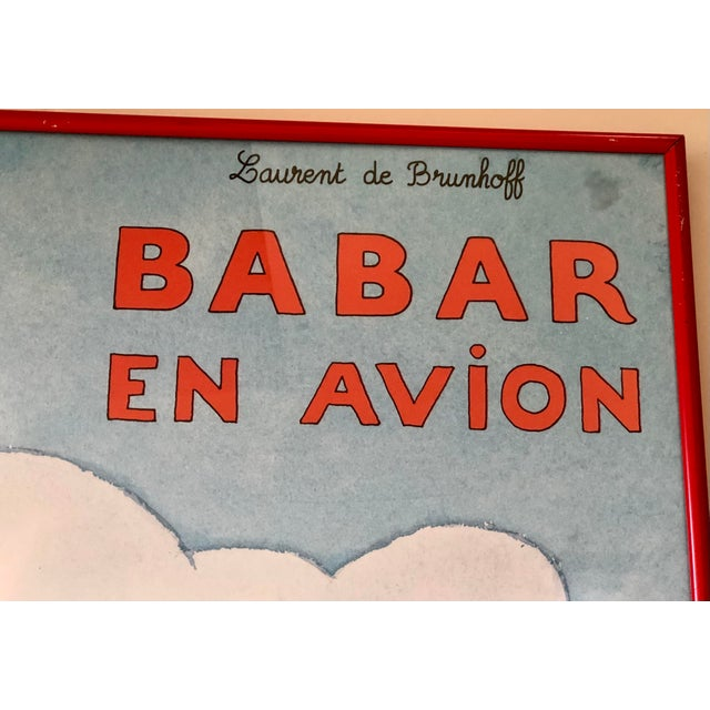 Lovely French children's art of the beloved Babar flying above his village in a red airplane with his friend. Finished in...