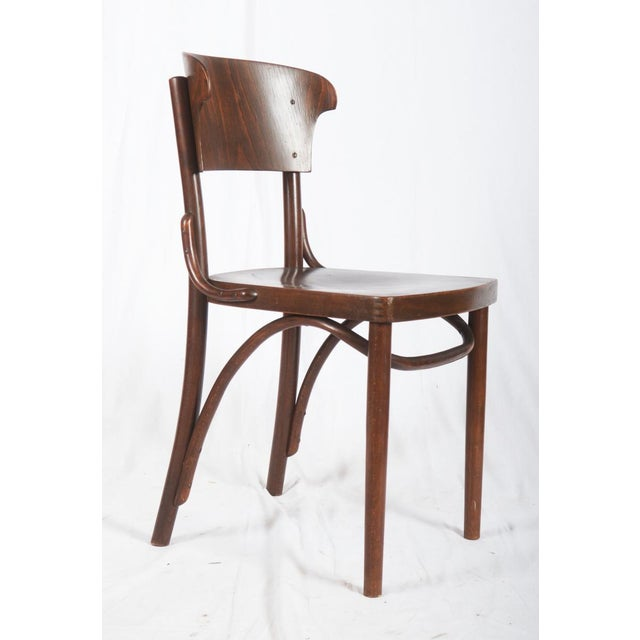 This set of solid bentwood chairs was manufactured in the 1930s. The shape of the backrest is reminiscent of Richard...