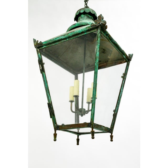 "Large, English lantern with gorgeous green patina. Four candle covered sockets, glass encased. Newly rewired. 34"" height,..."