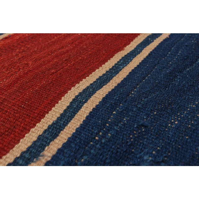 kilims constructed from local hand-spun sheep wool and vegetable dyes, focusing on the use of vibrant earthy colors. The...