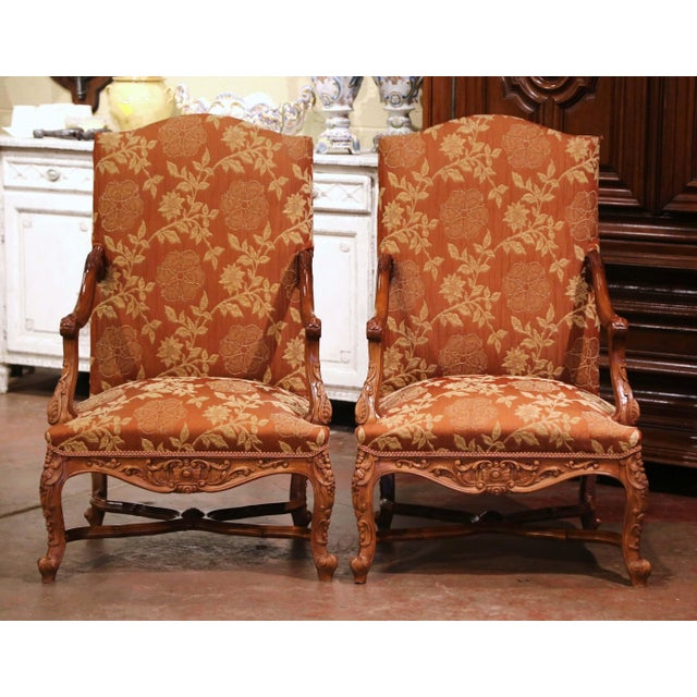 Crafted in Provence, France circa 1880, each comfortable fauteuil sits on cabriole legs decorated with acanthus leaves at...