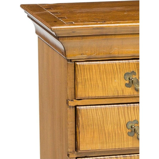 An antique American Chippendale style curly maple (also called tiger or figured maple) chest on stand from the 19th...