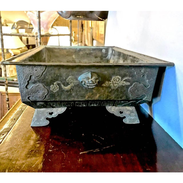 This is a large bronze Hibachi or bulb planter that dates to the later Japanese Edo Period. The bronze hibachi is detailed...