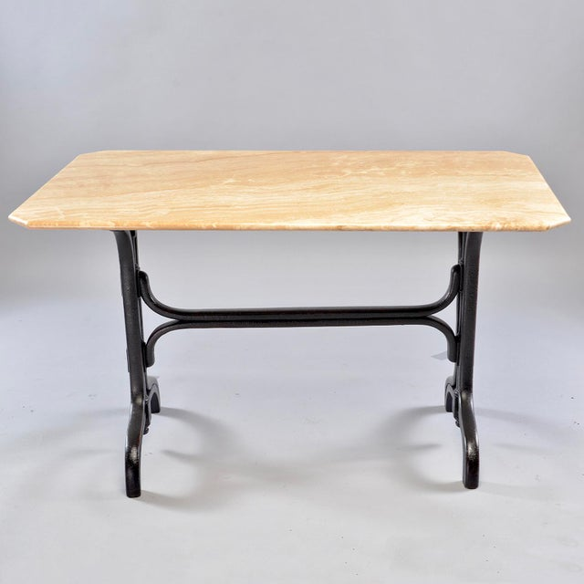 Versatile sized pub table has creamy beige marble top sits on a circa 1930s bentwood base with an ebonised finish. DEALER...