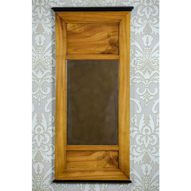 We present you a medium-sized mirror in a simple, rectangular Biedermeier frame. This item is from the 1st half of the...