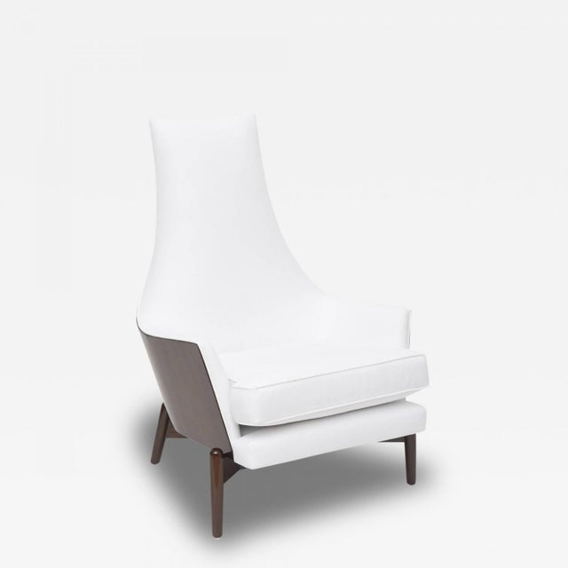 the dark walnut framework laminating the back and sides of the entire chair, on an x form stretcher with round tapering legs