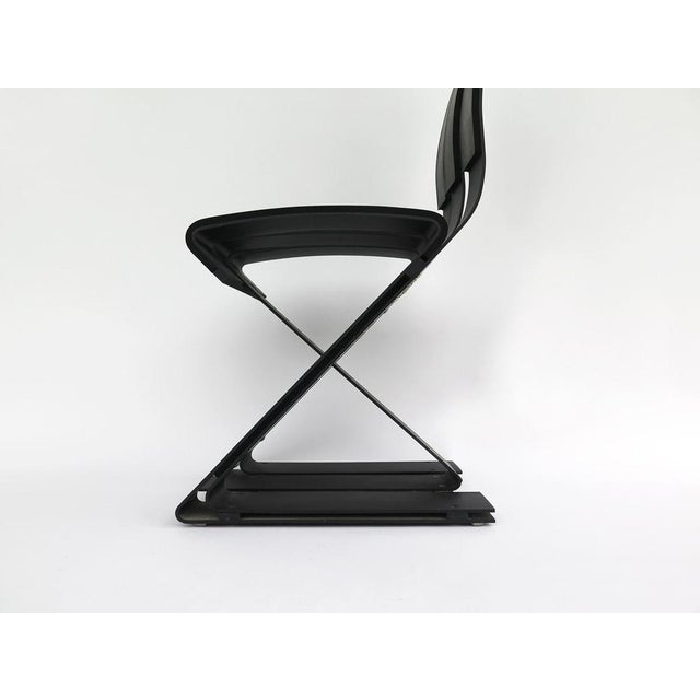 """Ron Arad """"School Chair"""" Hatchi Design Paris 1990, black aluminum blade structure partially covered with six strips of..."""