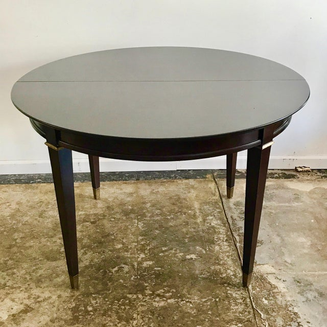 Vintage mahogany round dining table in neoclassic style. Stripped and re-stained a dark mahogany color to make it richer...