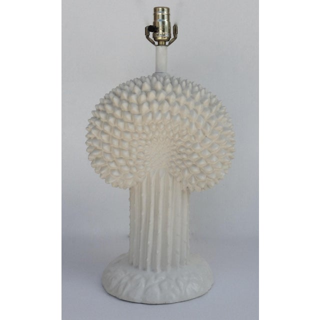 Vintage; Mid-Century, John Dickinson plaster lamp in a quasi palm trunk with vertical cactus ridge, fluted base. While the...